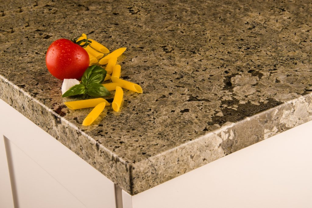 close up of kitchen granite countertop with tomato and pasta on it