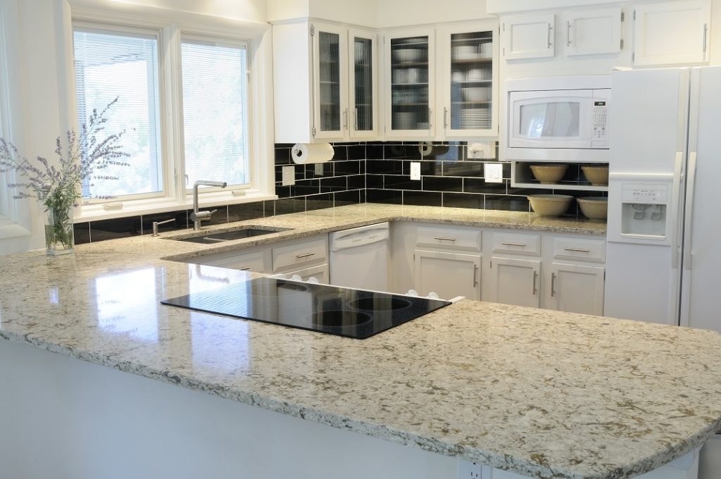 kitchen with brand new quartz countertops in beige and white