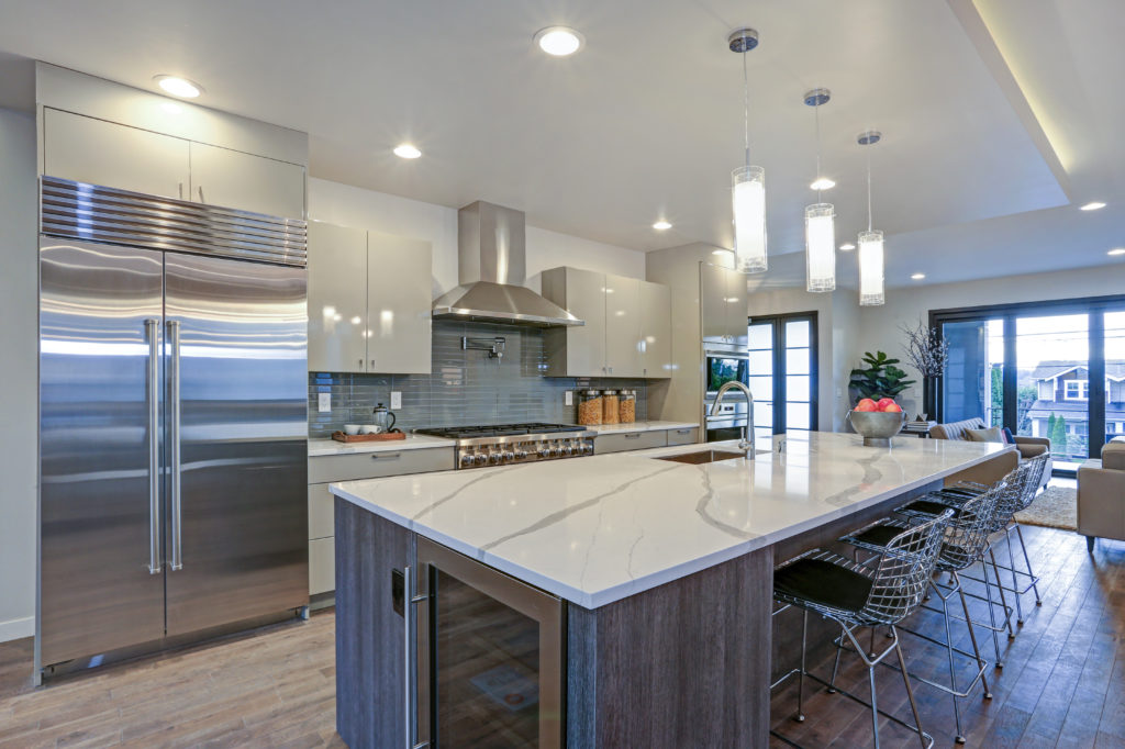 a beautiful kitchen with a quartz countertop