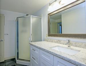 a beautiful granite sink in a bathroom